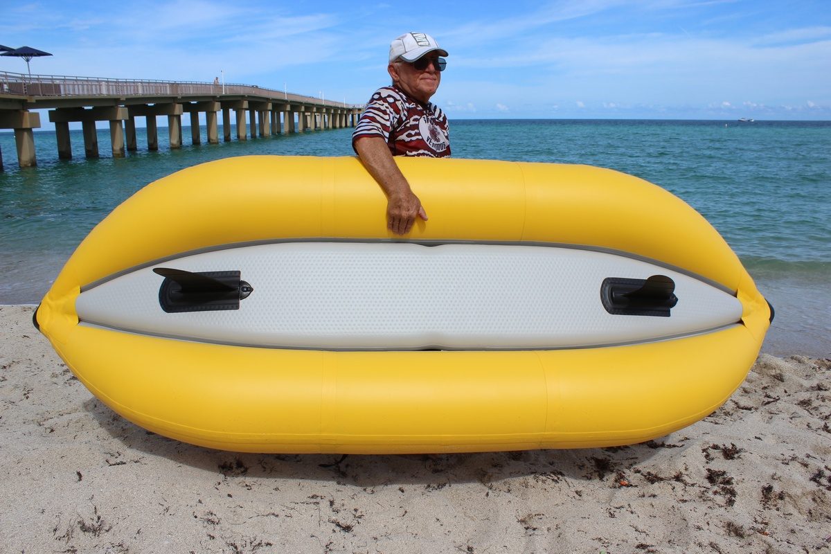 """8'6"""" Saturn Inflatable River Kayak - Showing Self-Bailing Floor and Detachable Fins"""