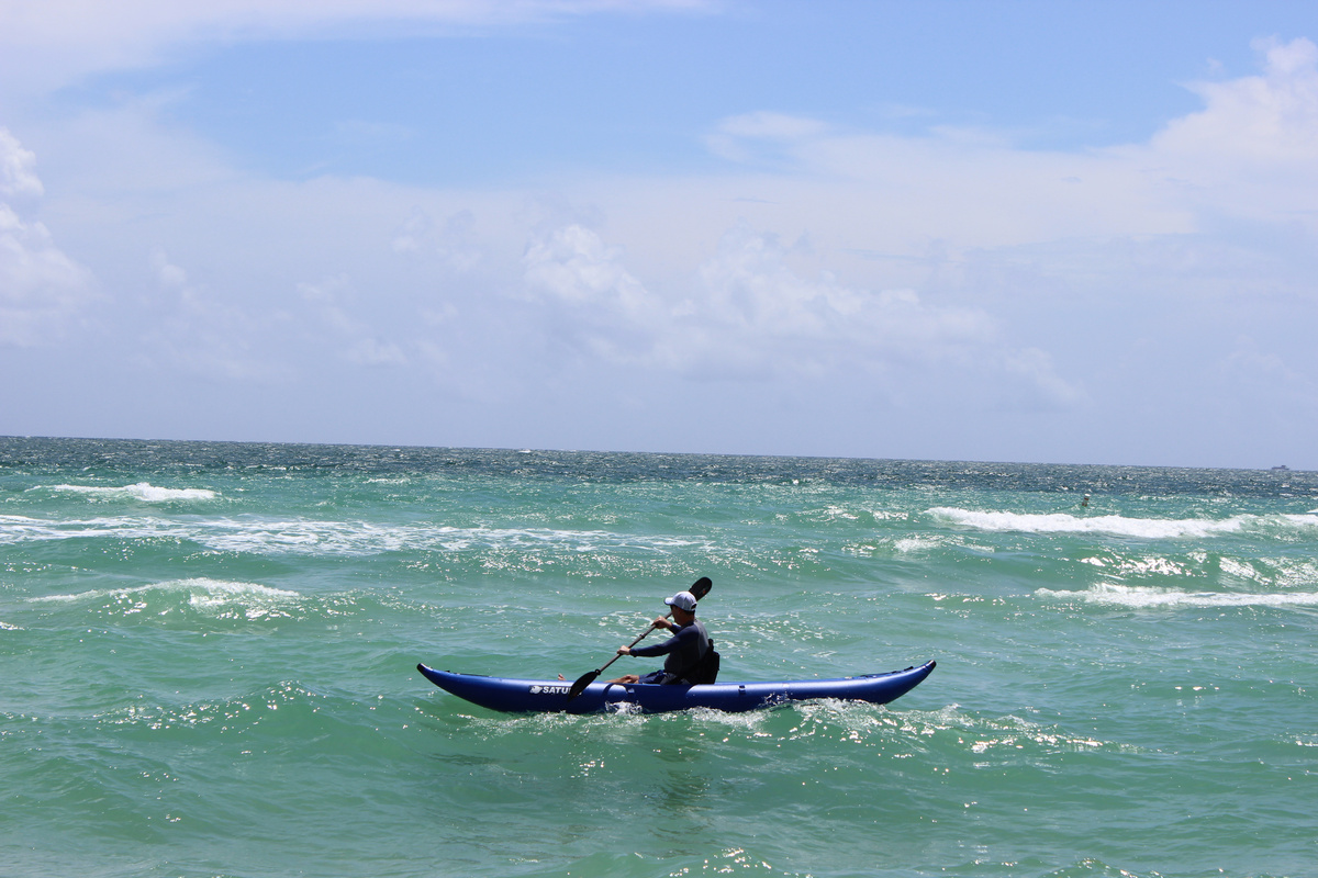 Customer Photo - 14' Saturn Ocean Kayak in the Surf